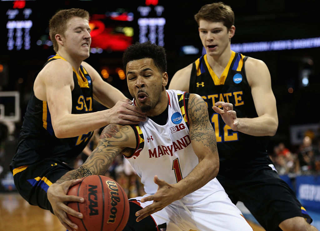 SPOKANE, WA - MARCH 18: Reed Tellinghuisen #23 of the South Dakota State Jackrabbits fouls Jaylen Brantley #1 of the Maryland Terrapins as Keaton Moffitt #12 of the South Dakota State Jackrabbits looks on in the second half during the first round of the 2016 NCAA Men's Basketball Tournament at Spokane Veterans Memorial Arena on March 18, 2016 in Spokane, Washington. (Photo by Patrick Smith/Getty Images)