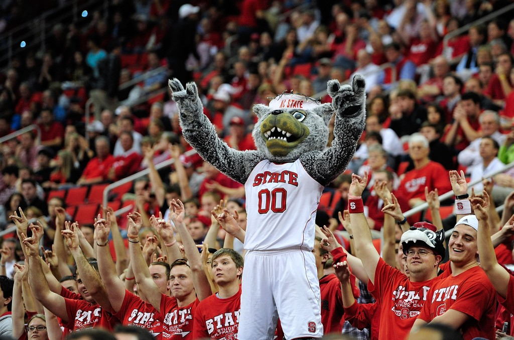 RALEIGH, NC - DECEMBER 18: Mr. Wuf, mascot of the North Carolina State Wolfpack, leads the cheers against the Stanford Cardinal during play at PNC Arena on December 18, 2012 in Raleigh, North Carolina. North Carolina State won 88-79. (Photo by Grant Halverson/Getty Images)