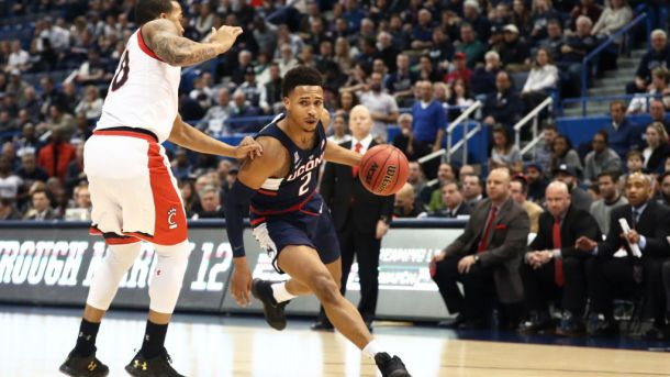 HARTFORD, CT - MARCH 11: Jalen Adams #2 of the Connecticut Huskies dribbles against the Cincinnati Bearcats during the semifinal round of the AAC Basketball Tournament at the XL Center on March 11, 2017 in Hartford, Connecticut. (Photo by Maddie Meyer/Getty Images)